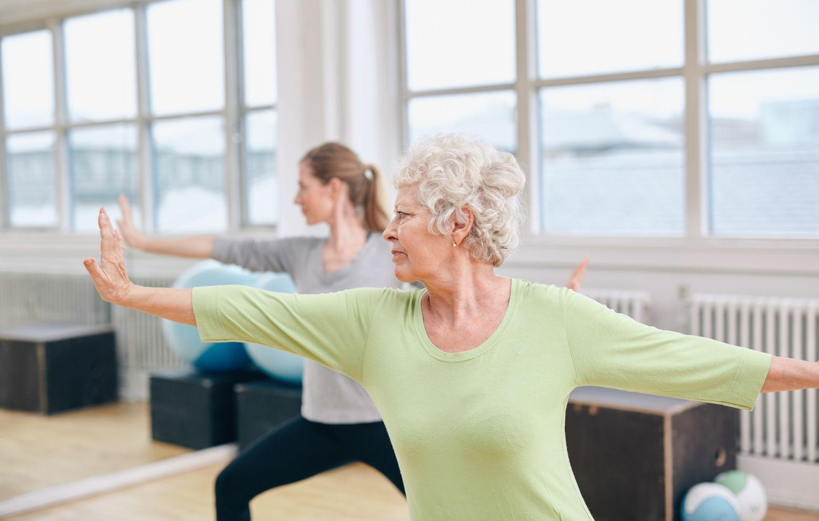 bigstock-Two-Women-Doing-Yoga-Workout-A-76765064